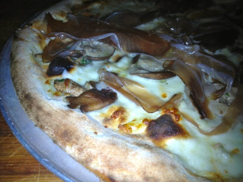 The thin-crust brick-oven pizza is served until 2 in the morning. We recommend this truffle-soaked speck and mushroom pie.