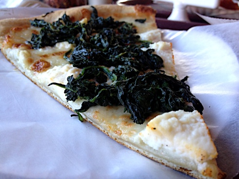 We suggest ordering spinach with your slice of white. Dollops of ricotta and a healthy sprinkling of garlic round out this excellent pizza.